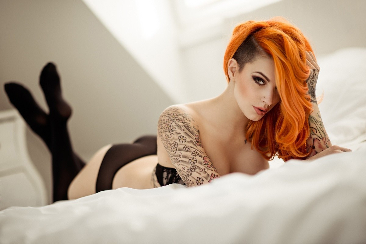 Sexy Tattooed Girl With Red Hair