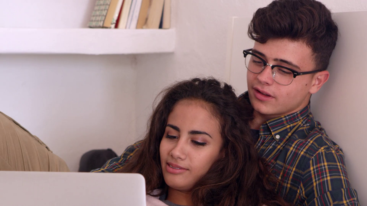 teenage-couple-hanging-out-in-bedroom-watch-laptop-close-up-shot-on-r3d_bwrbwxcfl_thumbnail-full01